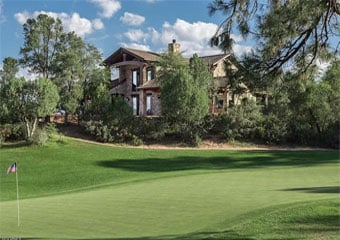 Image of a home on the green golf course in The Rim Golf Club