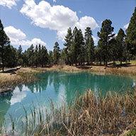 a blue lake in Torreon Golf Club